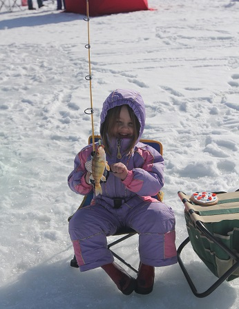Girl catches her first perch at Pineview